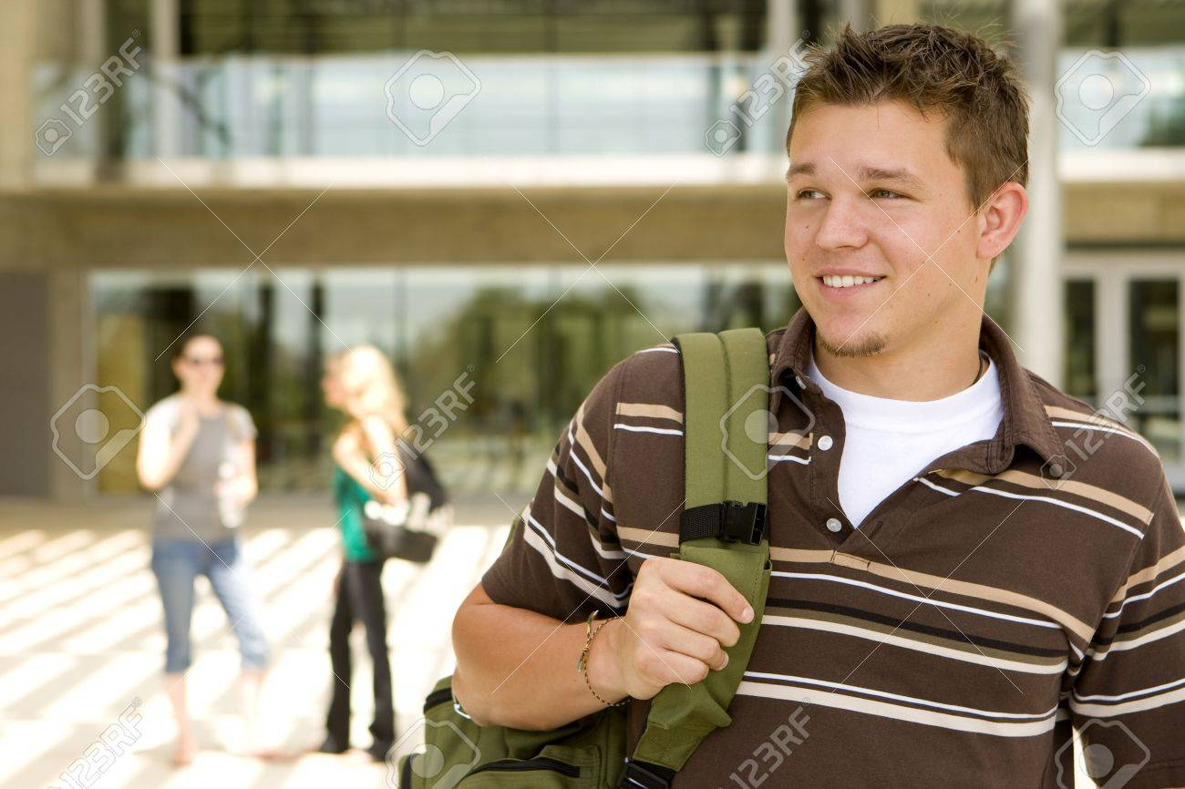 Young man at school holding a book bag - 5583390