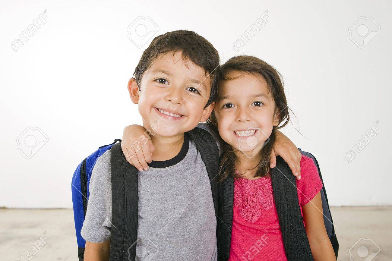 Little boy and girl with their book bags - 5679629
