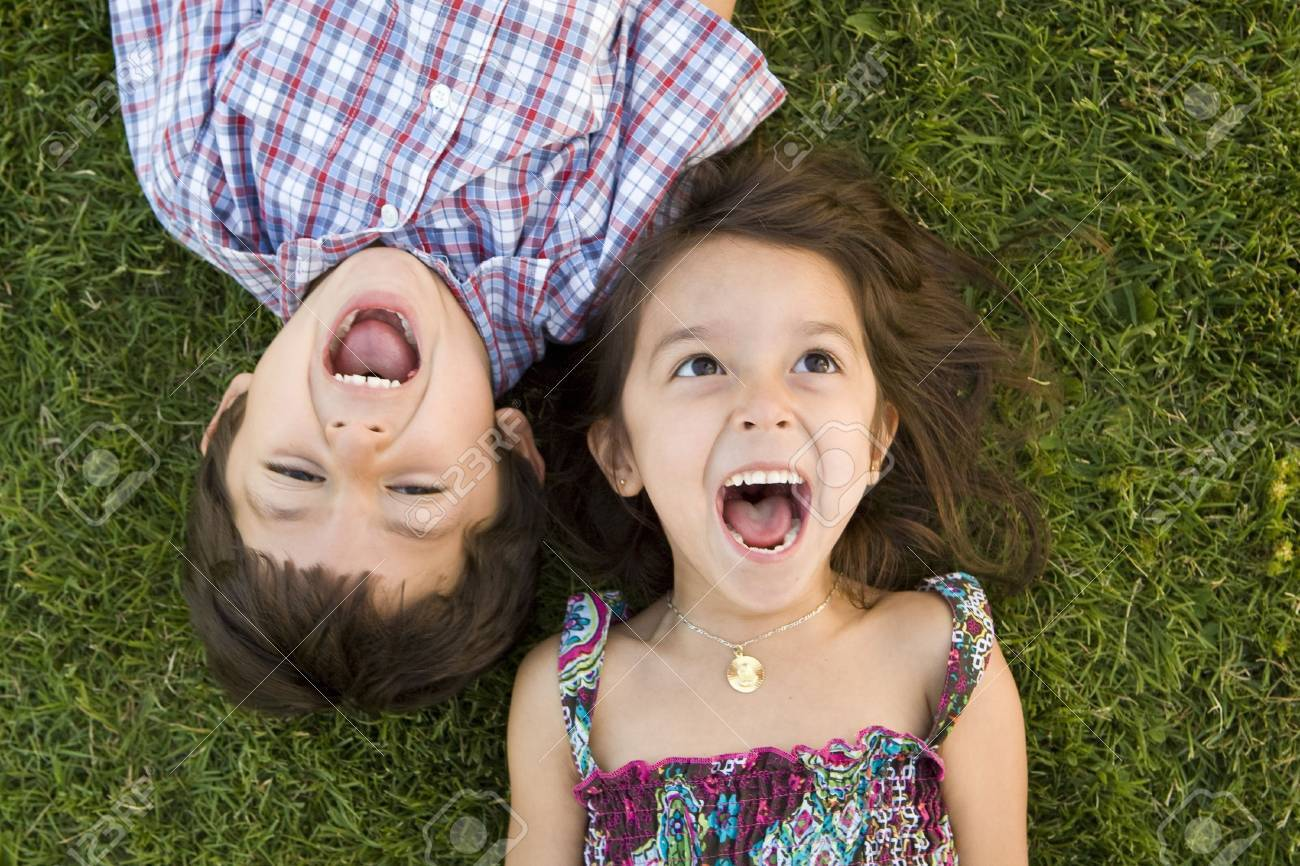 Brother and sister playing outside - 5679716
