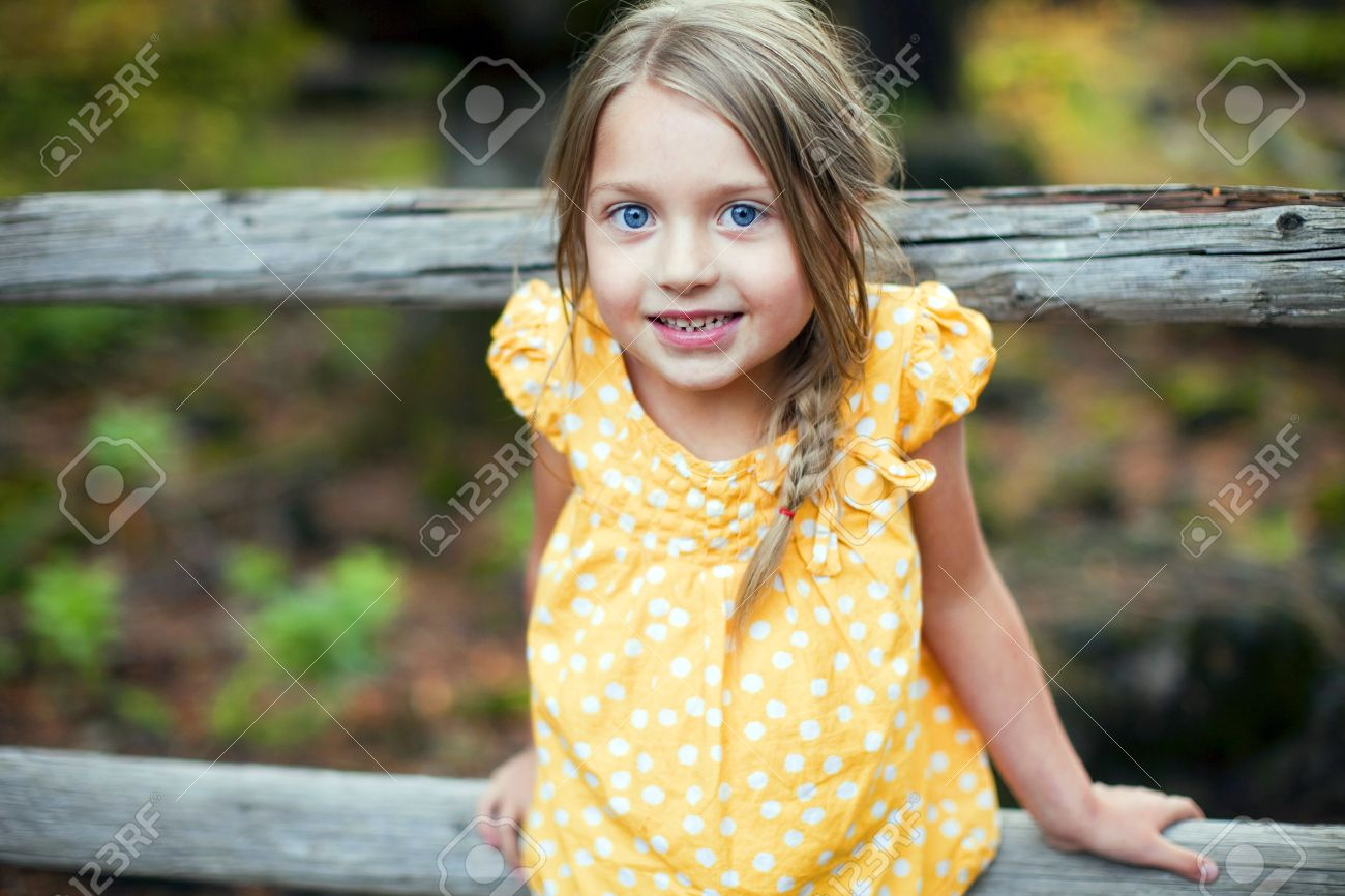 portrait of a cute little girl outside stock photo, picture and