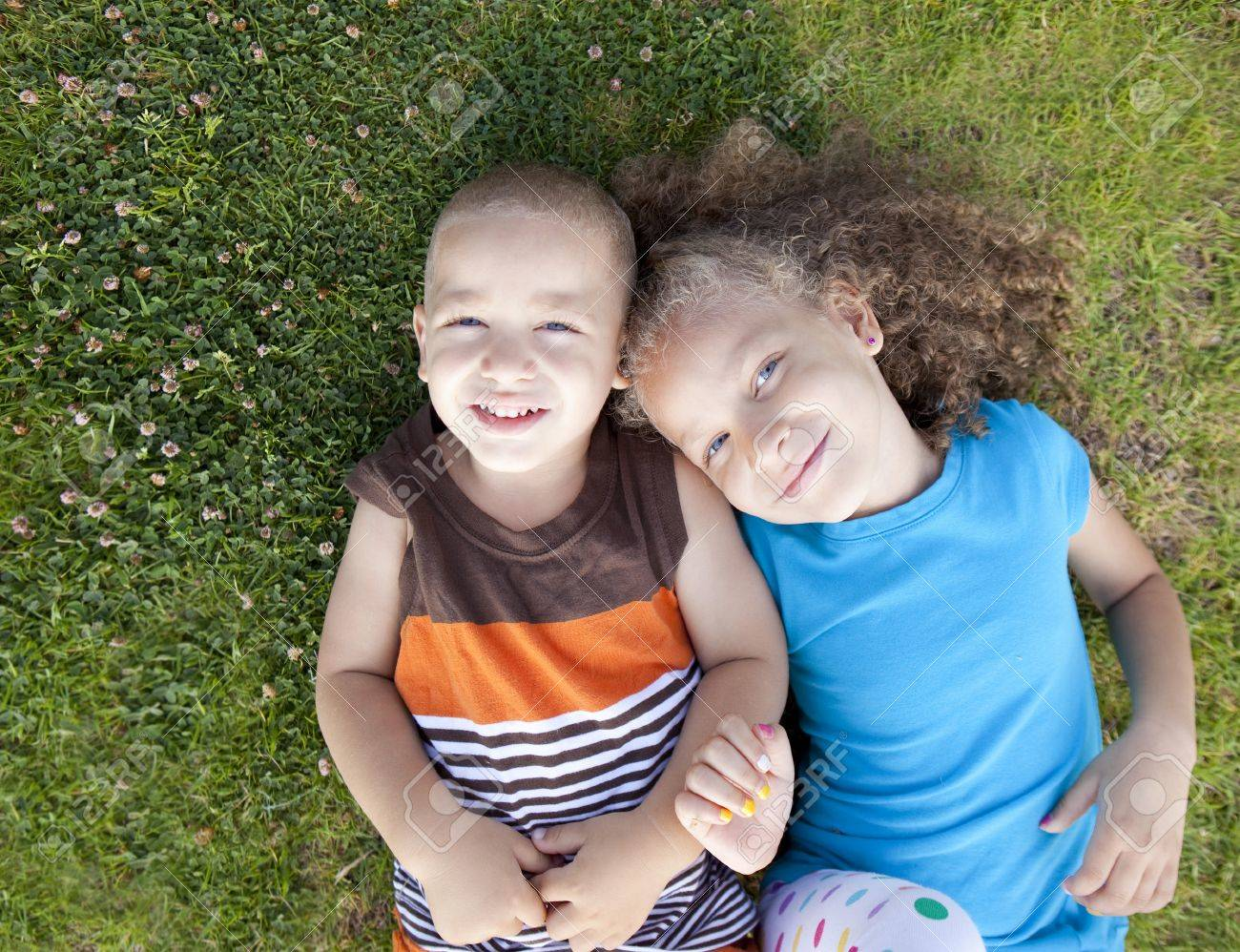 Brother and sister playing at a park - 10946651
