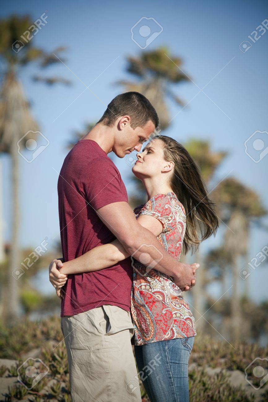 Loving couple at the beach - 10946603