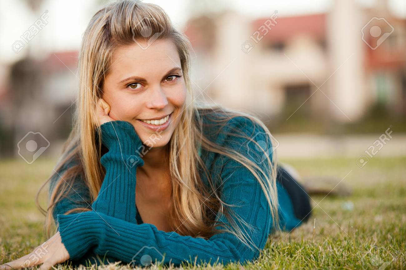Portrait of beautiful happy young woman outside - 18303845