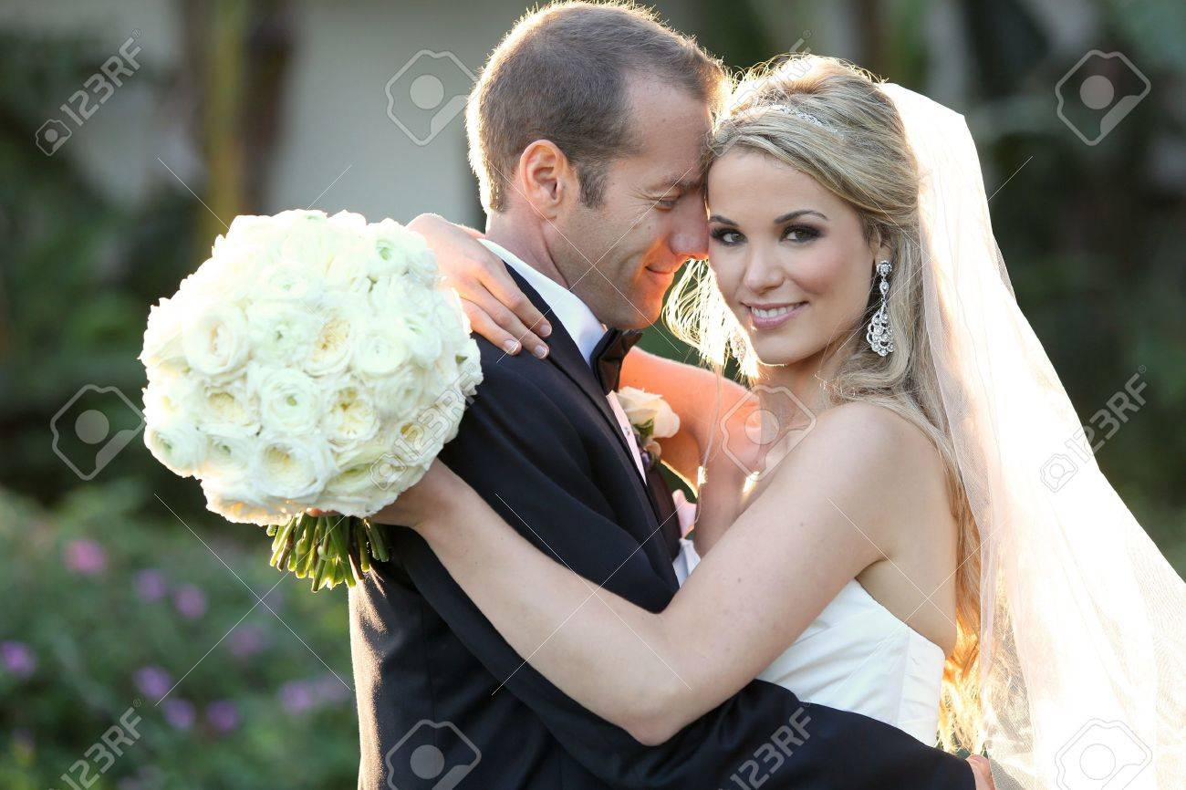 Happy bride and groom on their wedding - 18304550