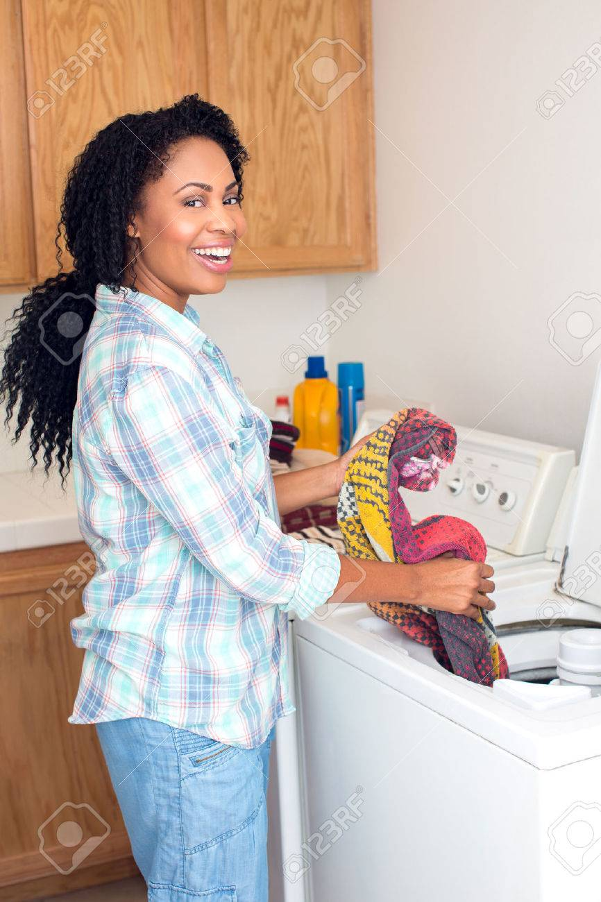 African american woman doing laundry - 46943327