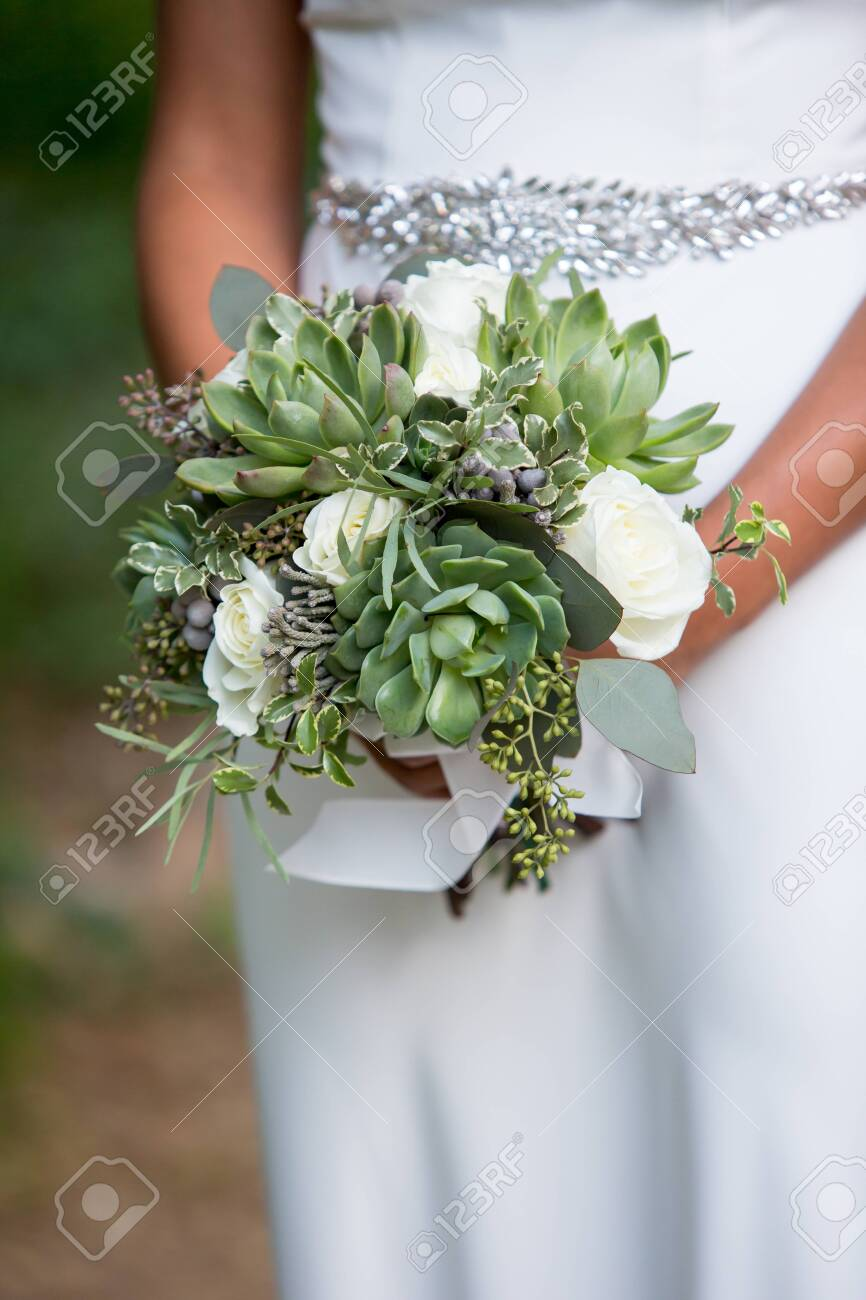 Bride Holding A Succulent Bouquet On Her Wedding Stock Photo Picture And Royalty Free Image Image 122470978