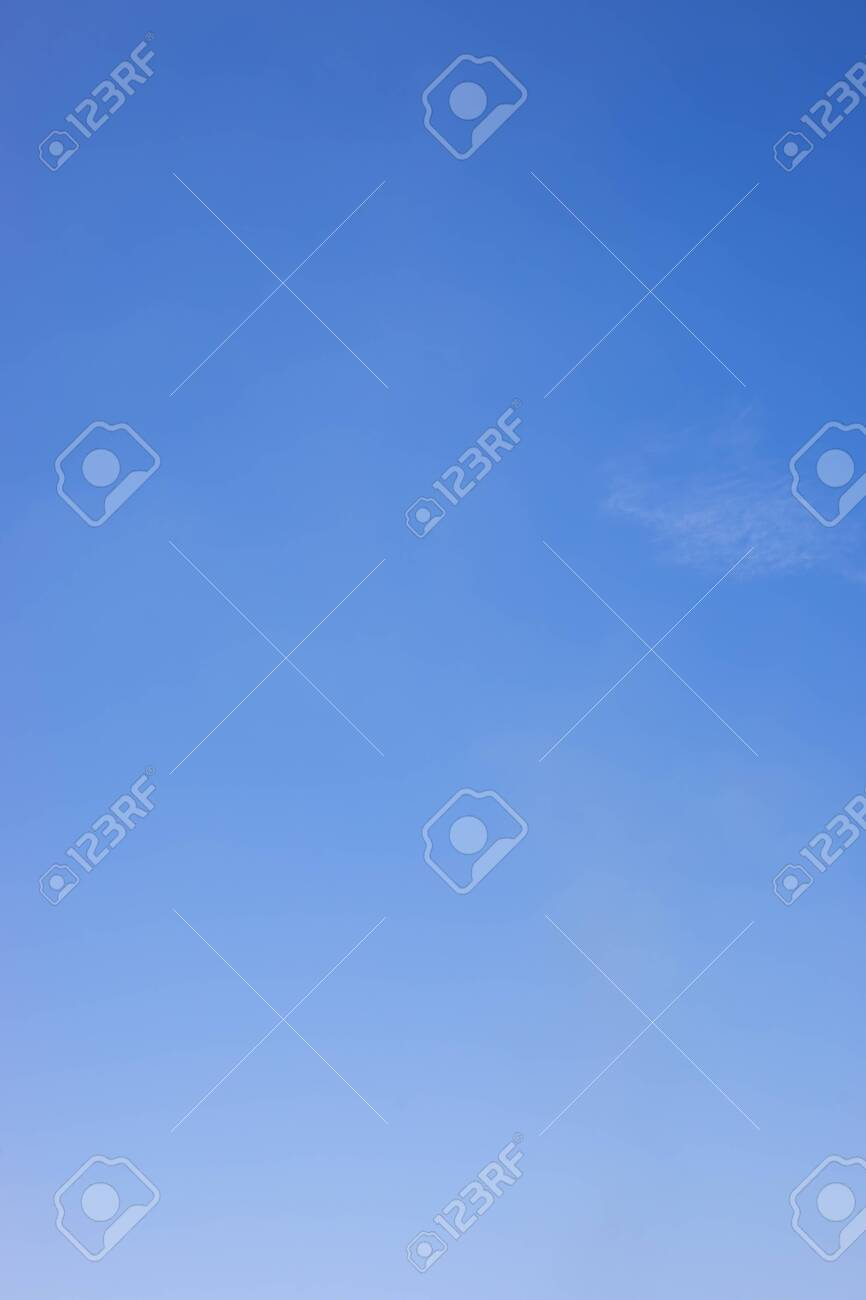 Blue sky background and white clouds soft focus, and copy space. - 121843987