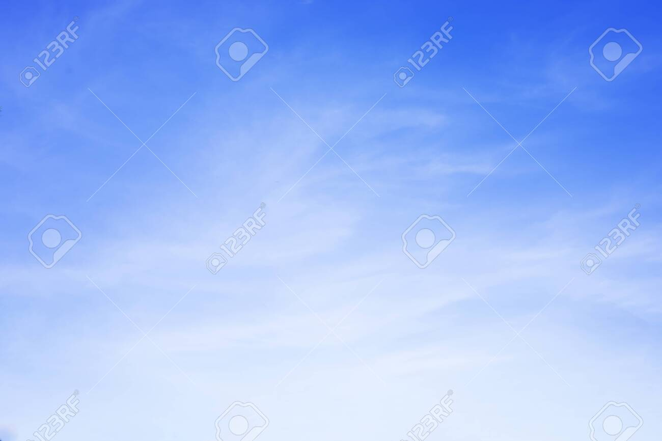 Blue sky background and white clouds soft focus, and copy space. - 129453203