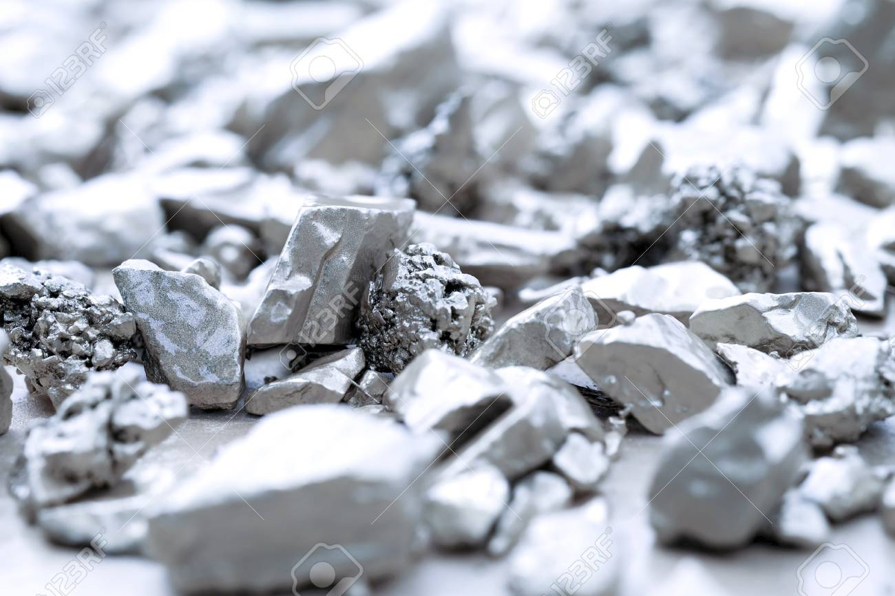 lump of silver or platinum on a stone floor - 100315736