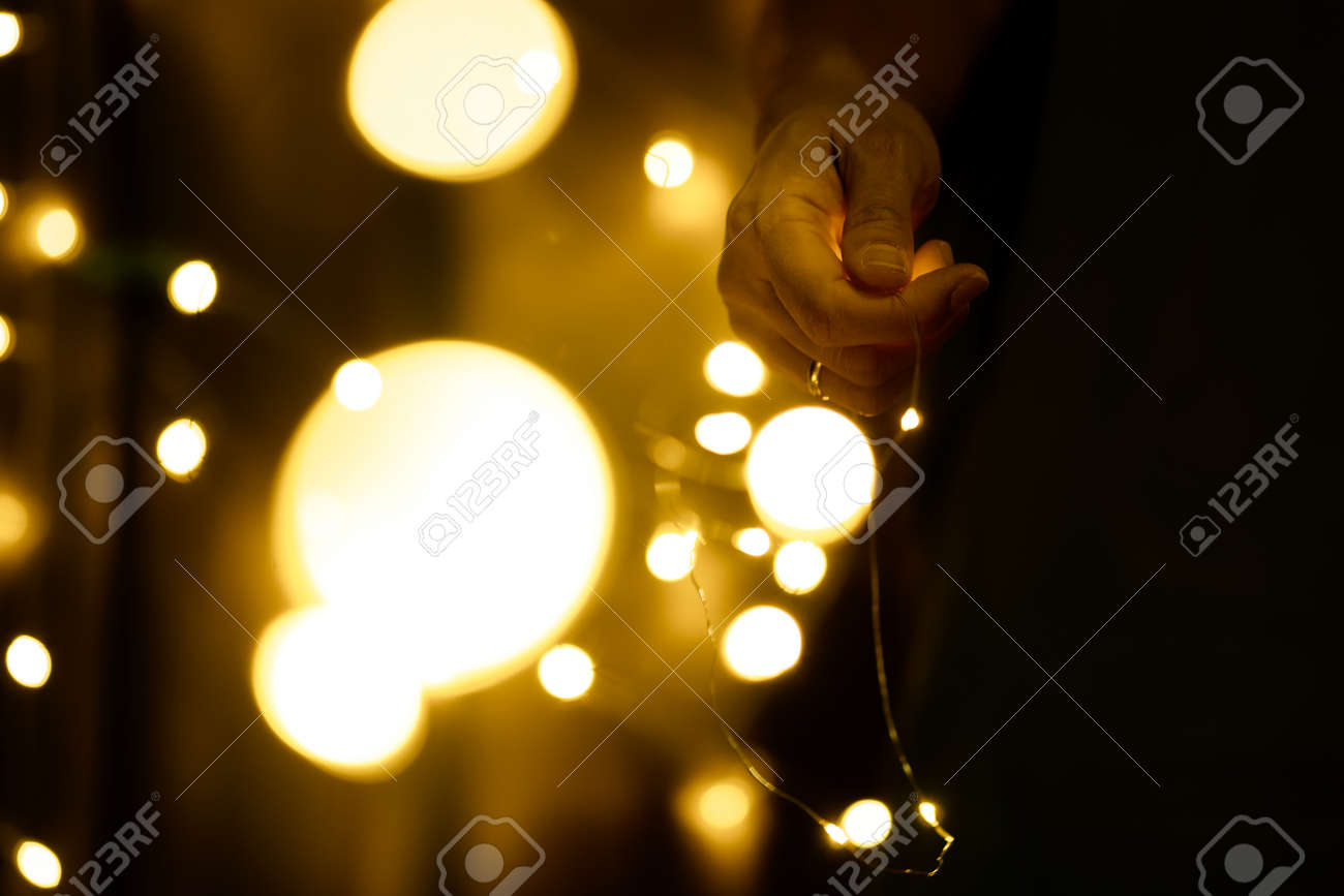 Christmas and Happy New Year decorations lighting in the hands of young women - 152014202