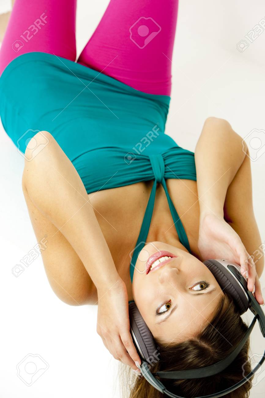 portrait of lying young woman with headphones Stock Photo - 5750389