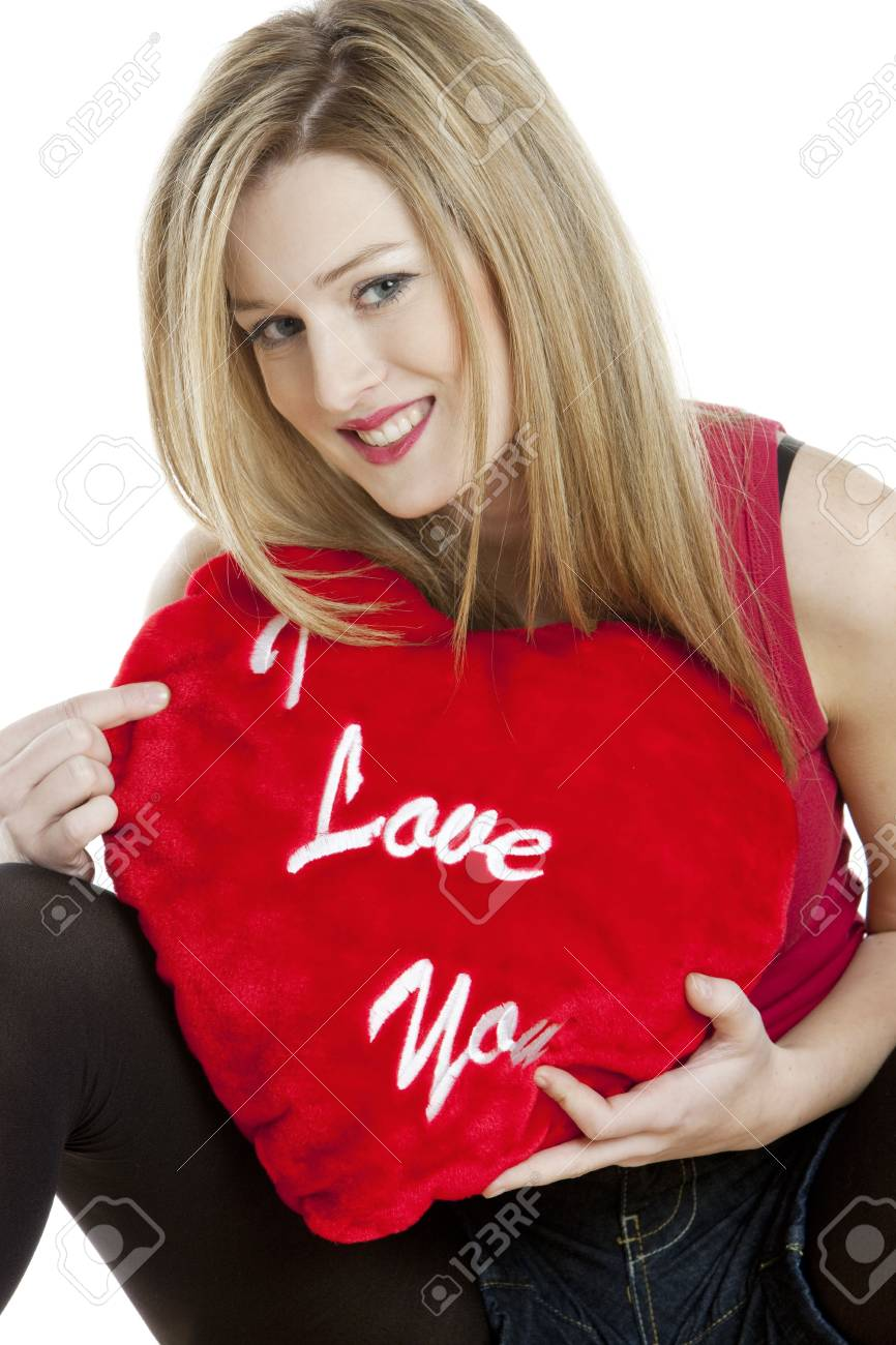 sitting young woman with heart Stock Photo - 6306722