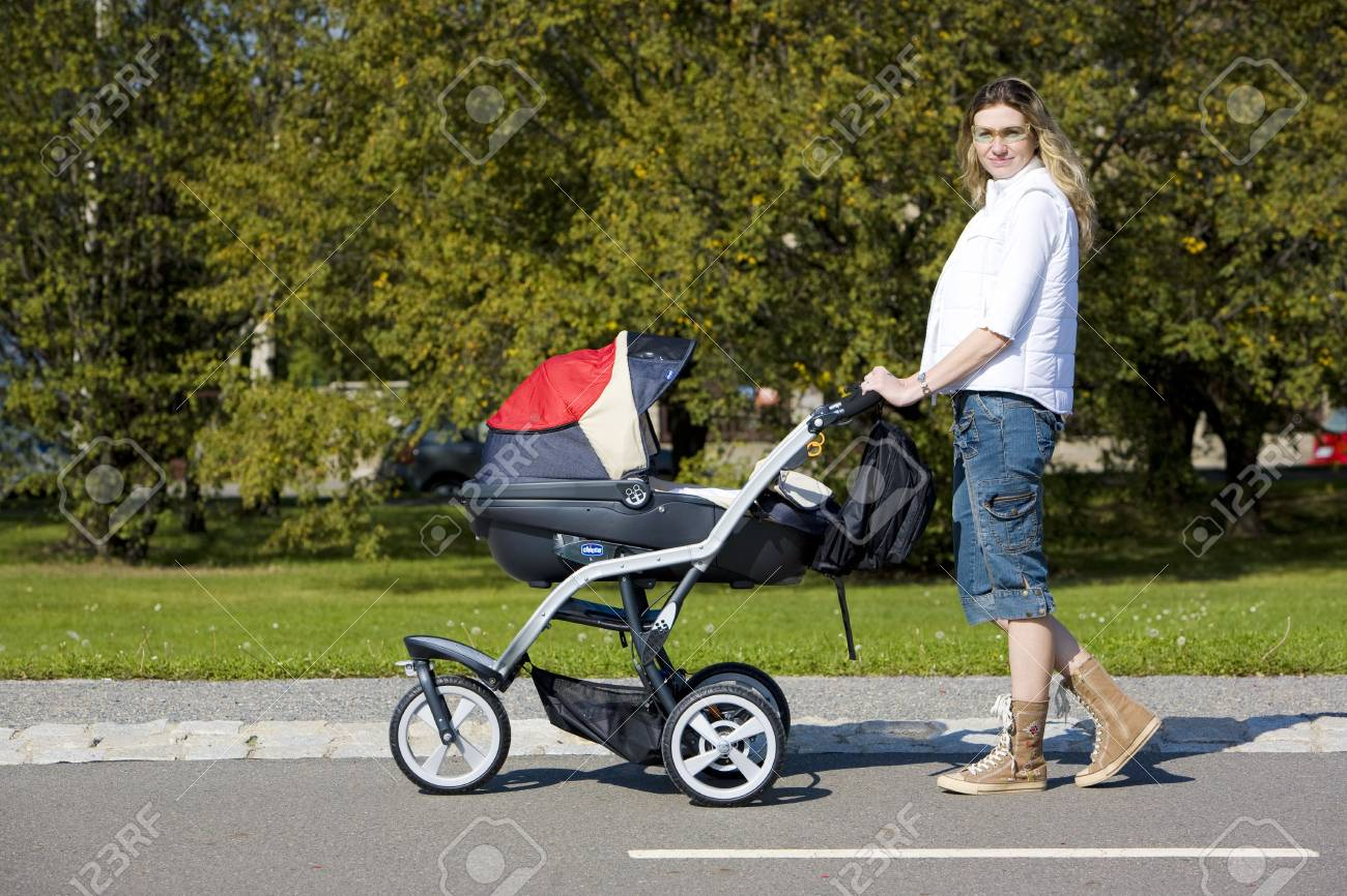 woman with pushing a pram Stock Photo - 6879108