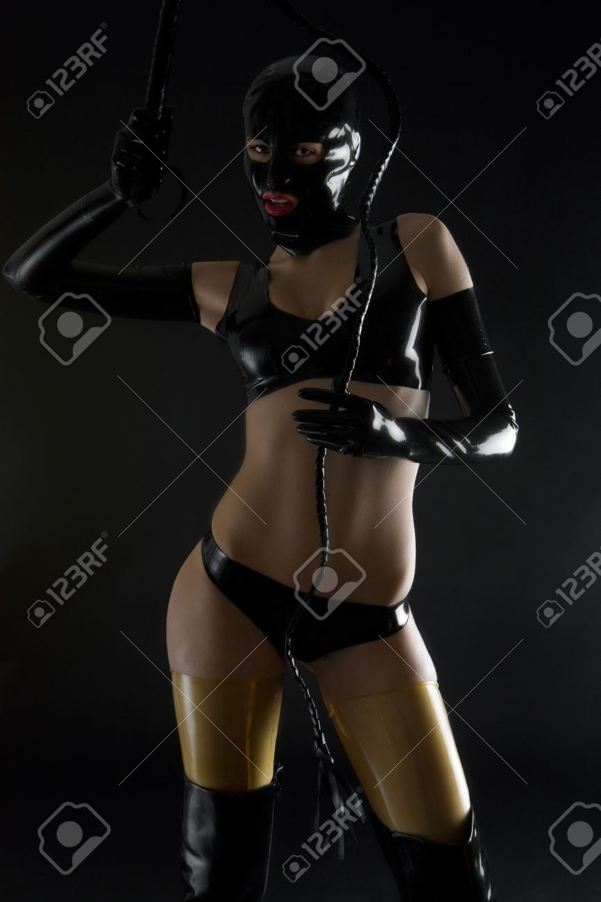 woman wearing latex clothes with whip Stock Photo - 6879152