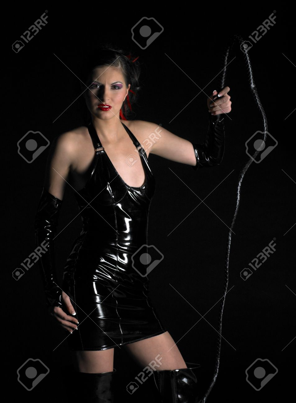 woman in latex with whip Stock Photo - 7384659