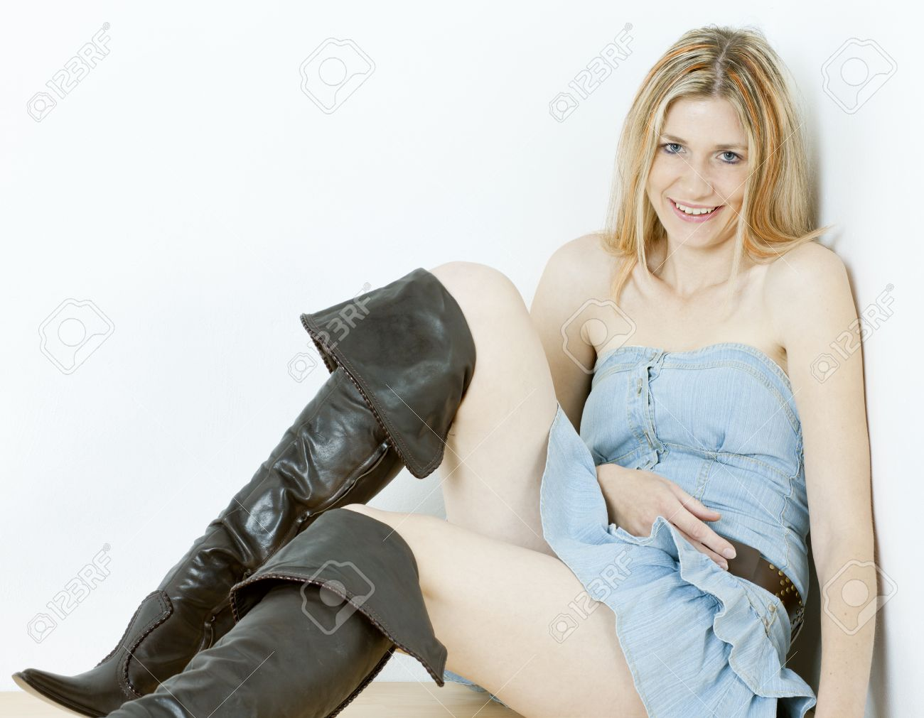 Sitting Woman Wearing Fashionable Brown Boots Stock Photo, Picture ...