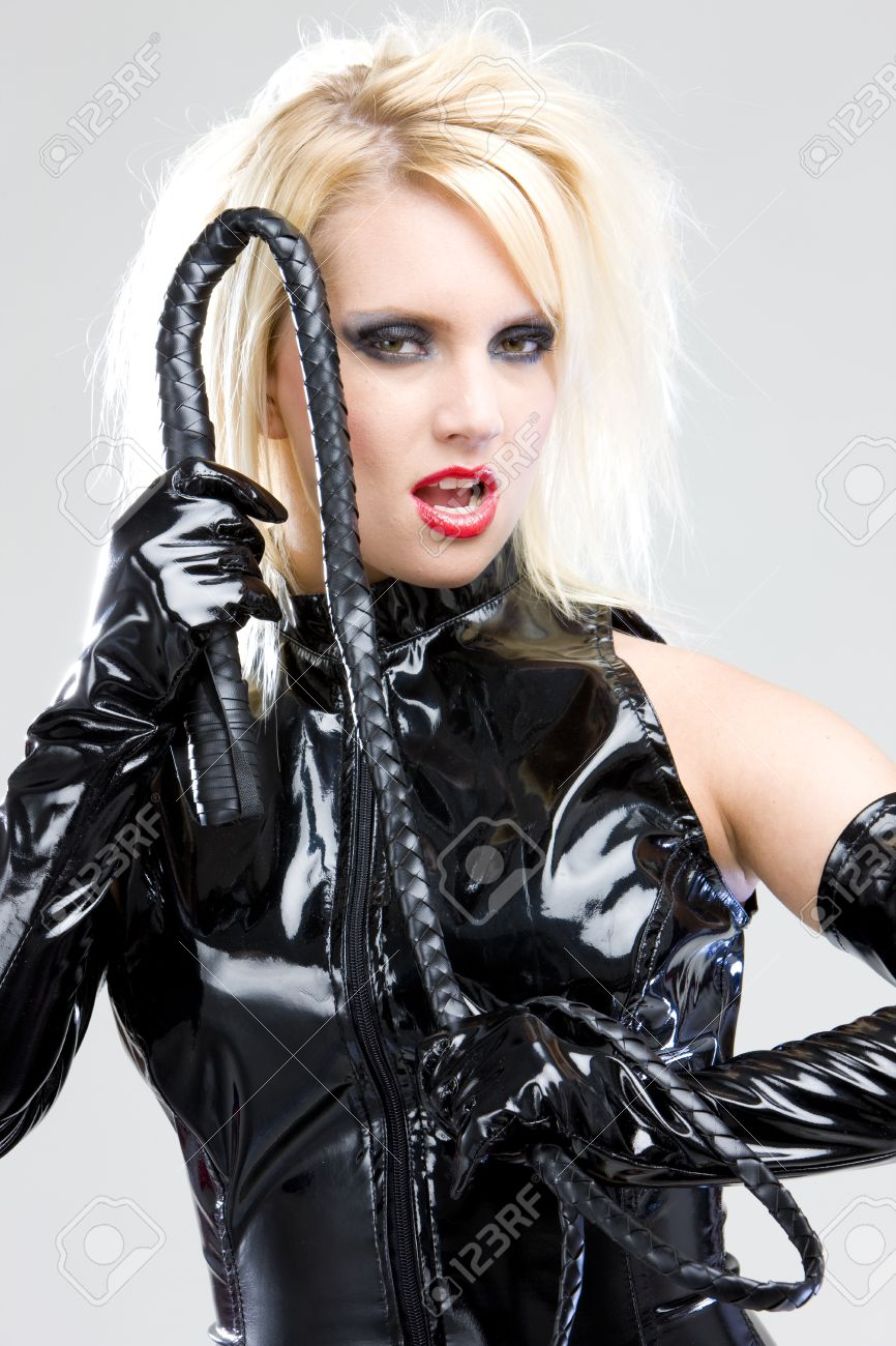 woman in latex with whip Stock Photo - 10479717