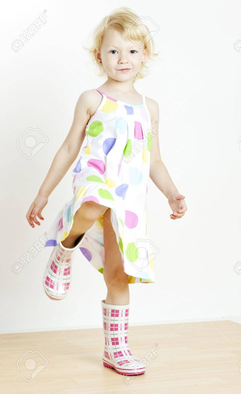 little girl wearing dress and rubber boots