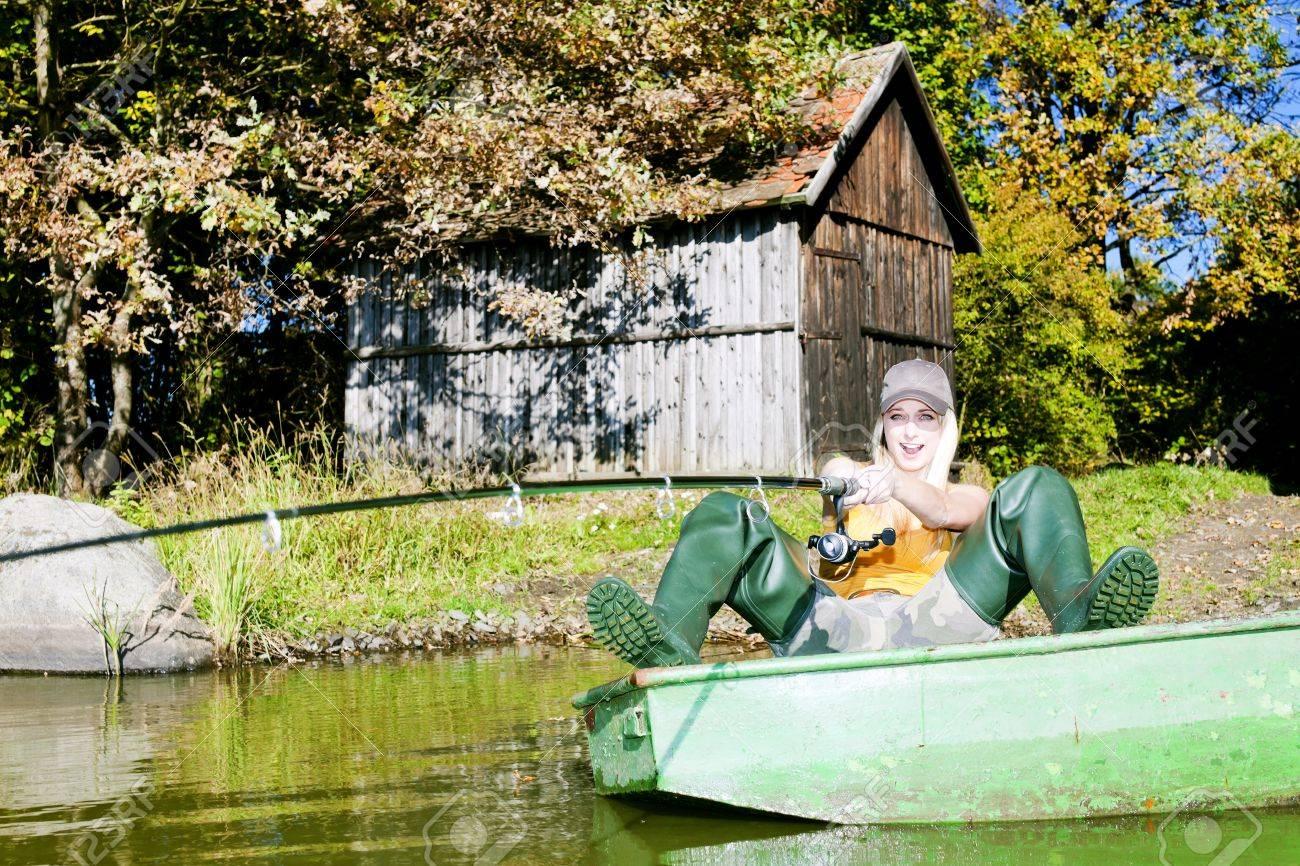 fishing woman sitting on boat Stock Photo - 10479848