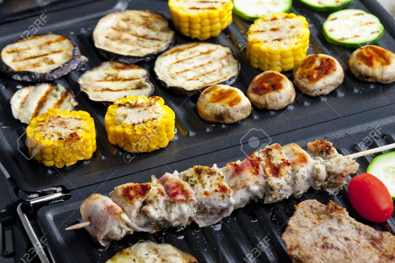 meat skewer and vegetables on electric grill Stock Photo - 13523830