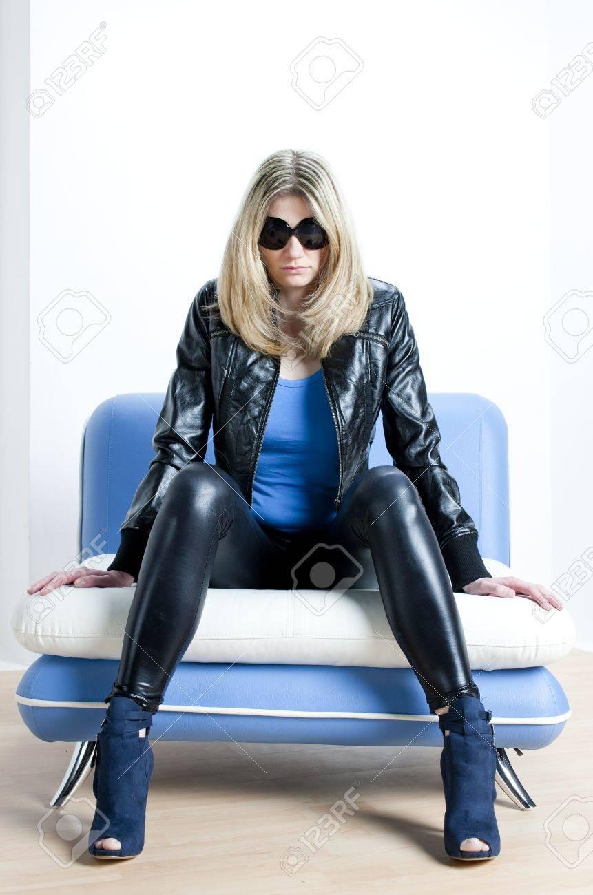 woman wearing fashionable shoes sitting on sofa Stock Photo - 13676731