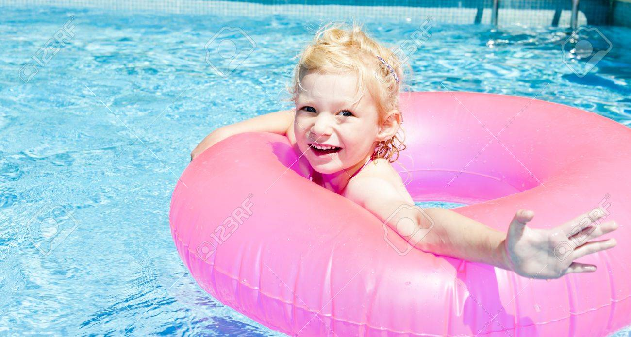 little girl with rubber ring in swimming pool Stock Photo - 13680749