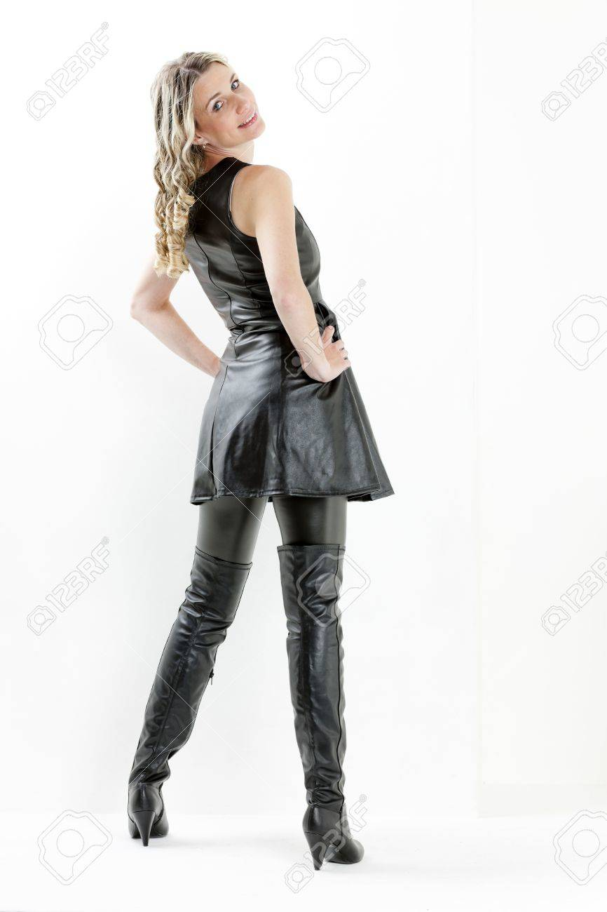 standing woman wearing black dress and black boots Stock Photo - 15466556