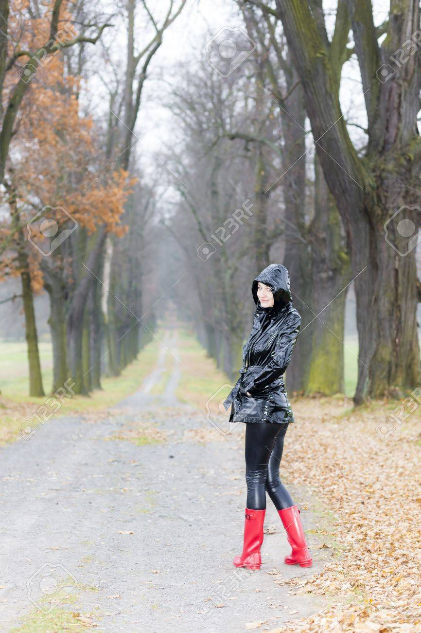 woman wearing rubber boots in autumnal alley Stock Photo - 15466688