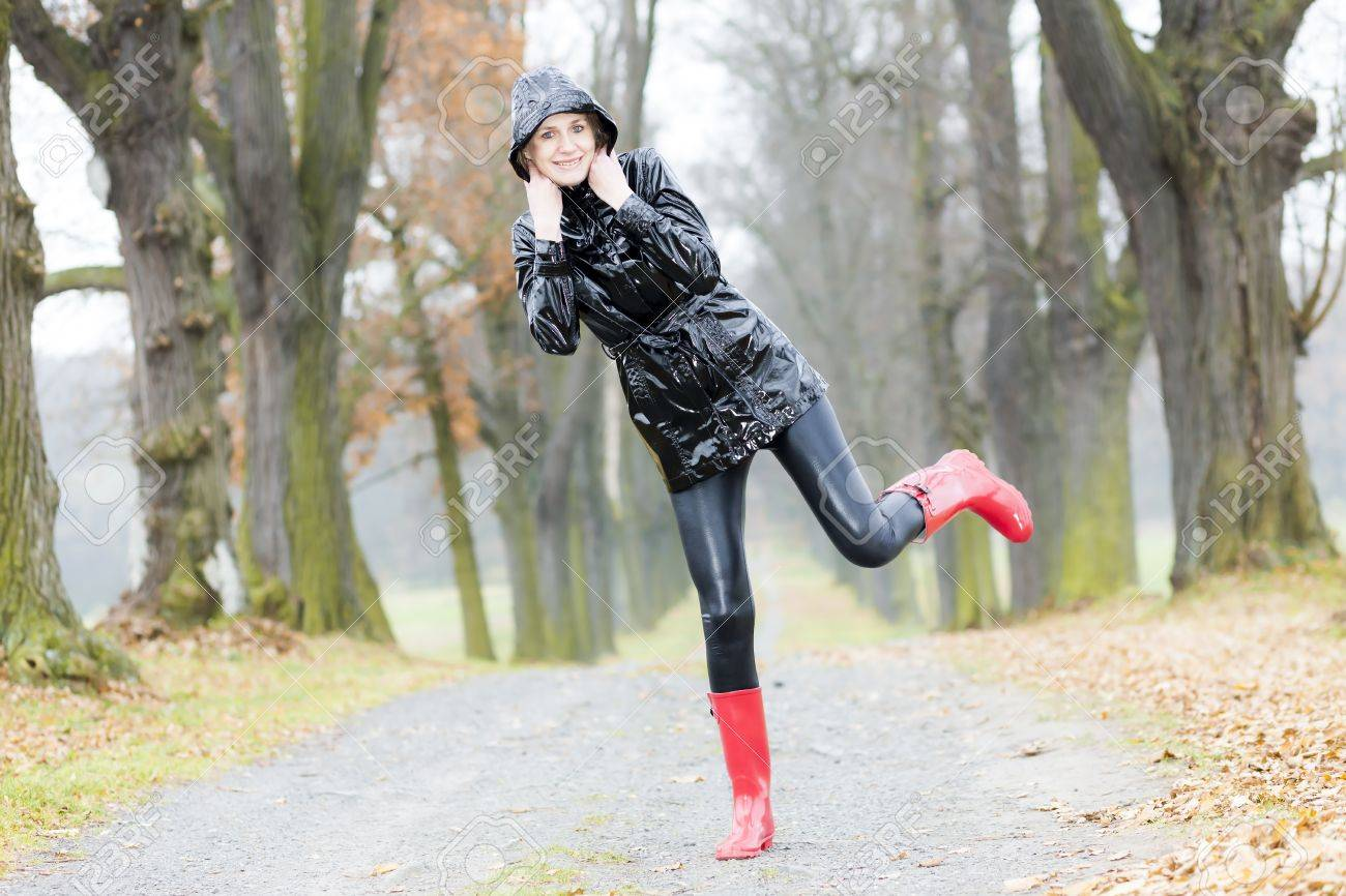 Woman Wearing Rubber Boots In Autumnal Alley Stock Photo, Picture ...