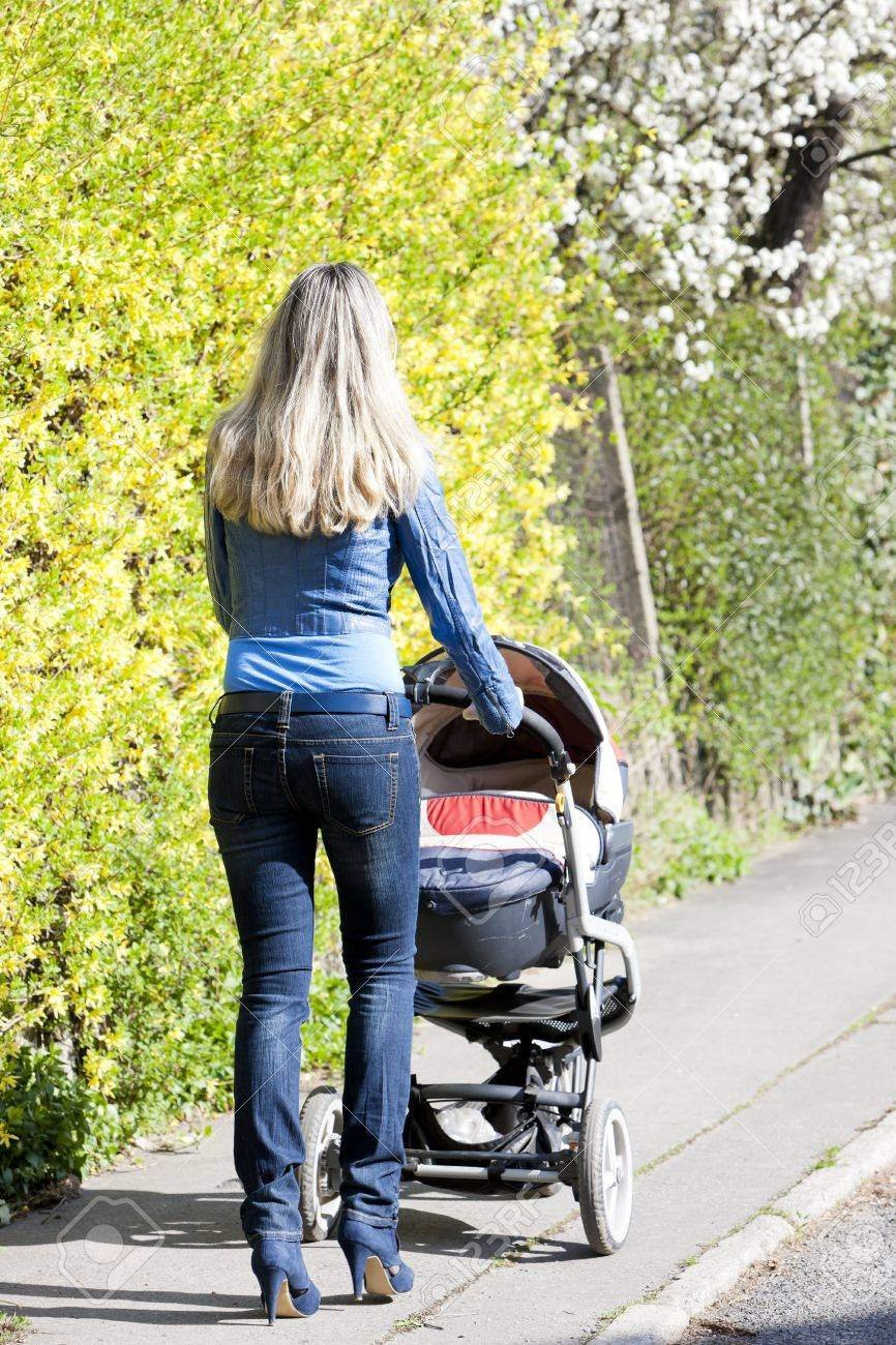woman with a pram on spring walk Stock Photo - 17718060