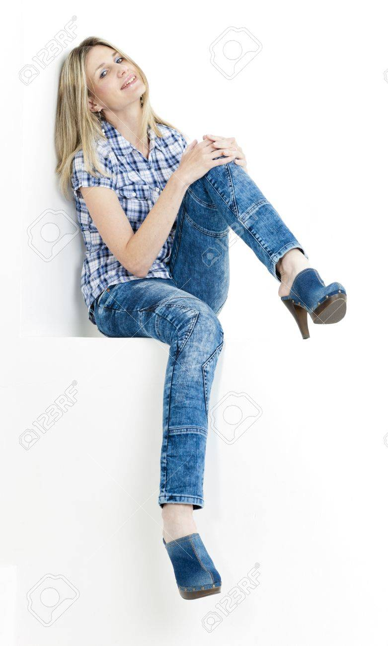 sitting woman wearing jeans and denim clogs Stock Photo - 18604280