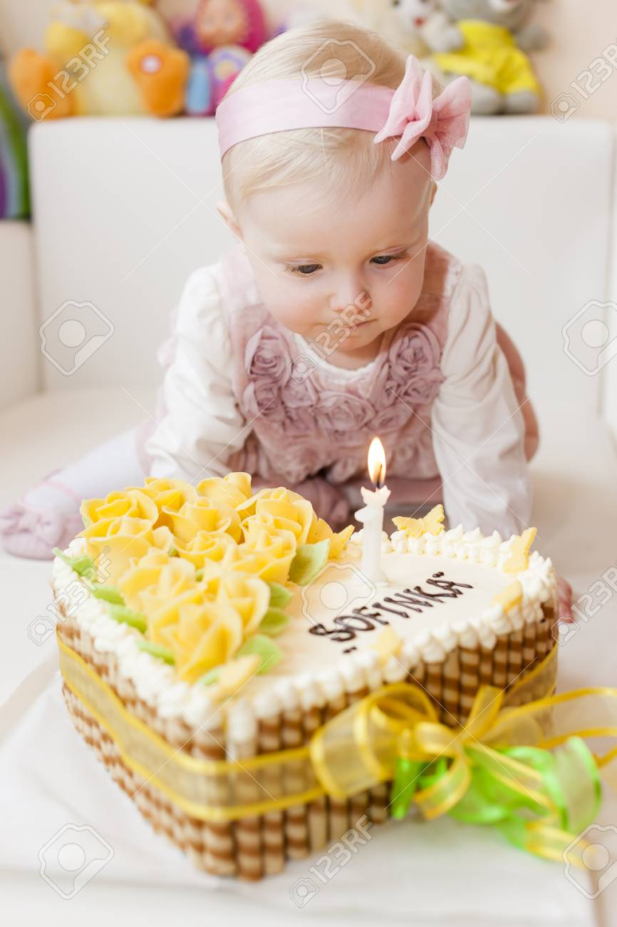 Astounding Portrait Of Sitting Toddler Girl With Her Birthday Cake Stock Birthday Cards Printable Nowaargucafe Filternl
