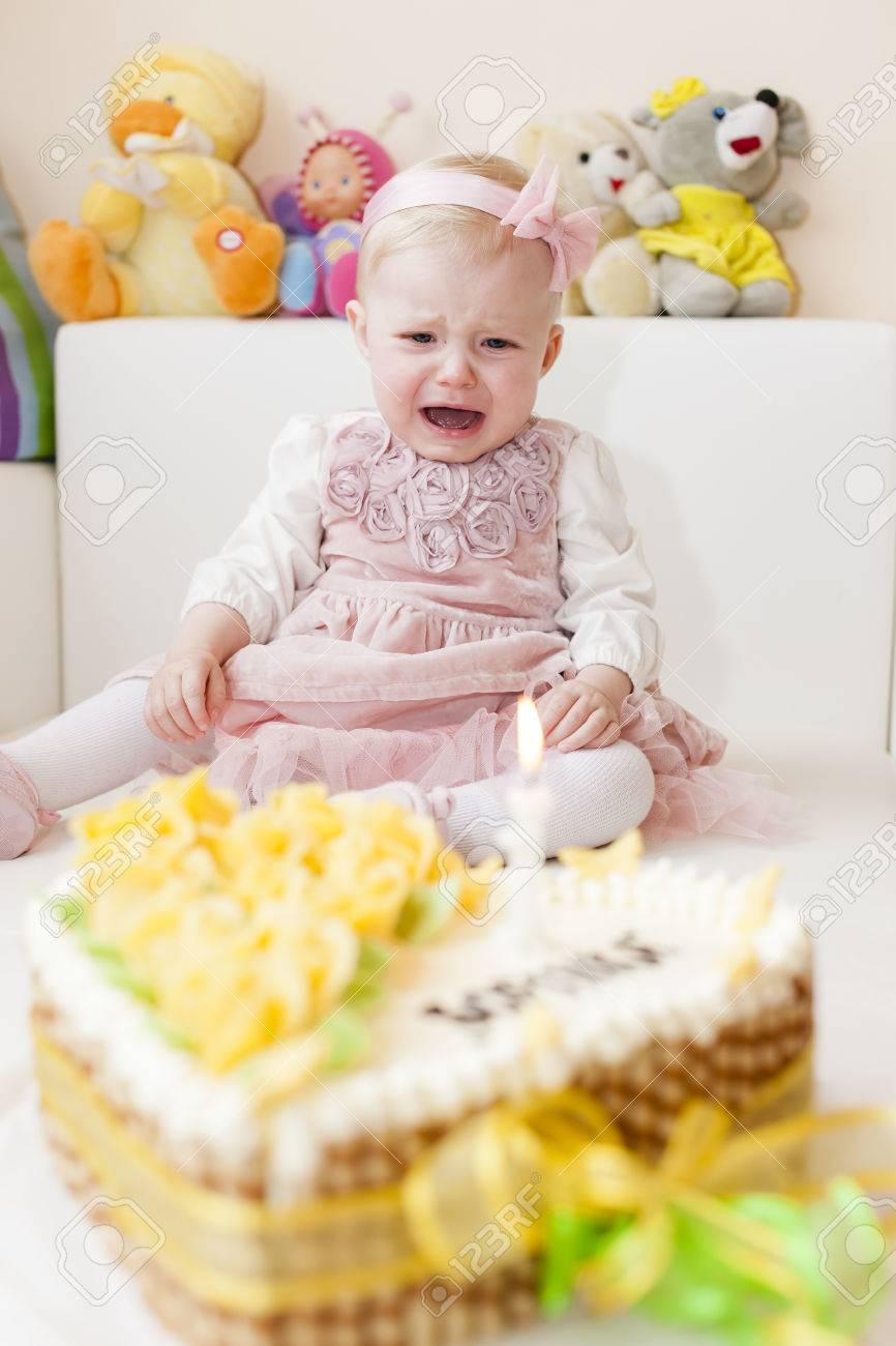 Surprising Sitting Toddler Girl With Her Birthday Cake Stock Photo Picture Birthday Cards Printable Benkemecafe Filternl