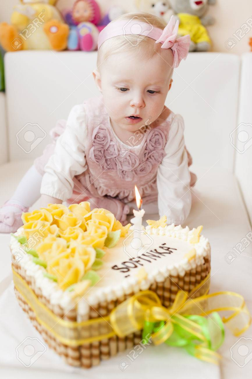 Groovy Portrait Of Sitting Toddler Girl With Her Birthday Cake Stock Birthday Cards Printable Benkemecafe Filternl