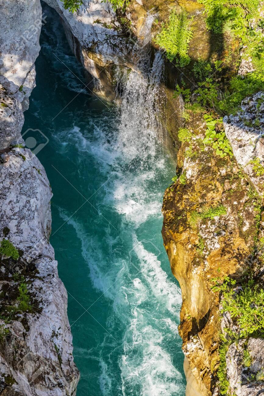 Waterfall to rriver Soca, Velika korita Soce, Triglavski national park, Slovenia - 134407549