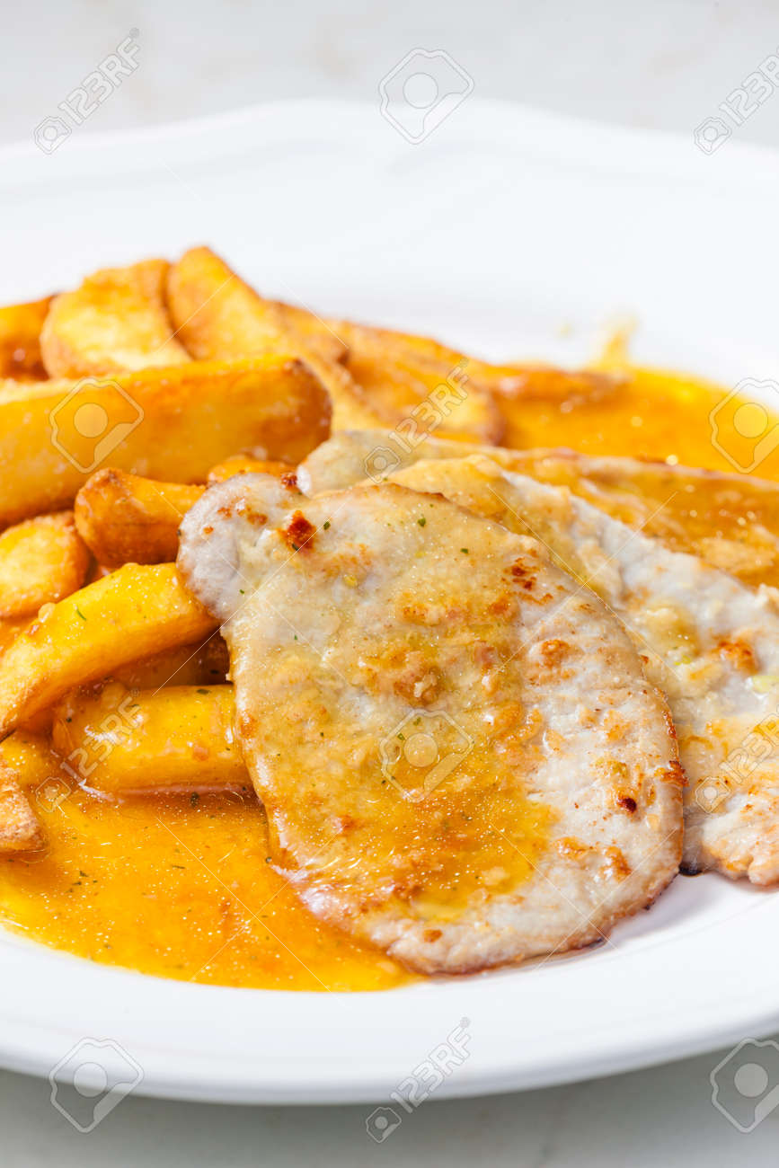 poultry meat on garlic with American potatoes and sauce - 169976135