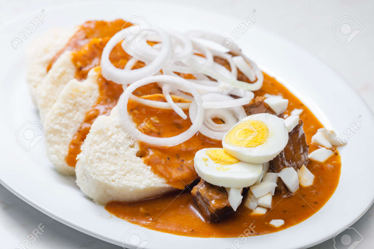 beef goulash with onion rings, boiled egg and dumplings - 169975714