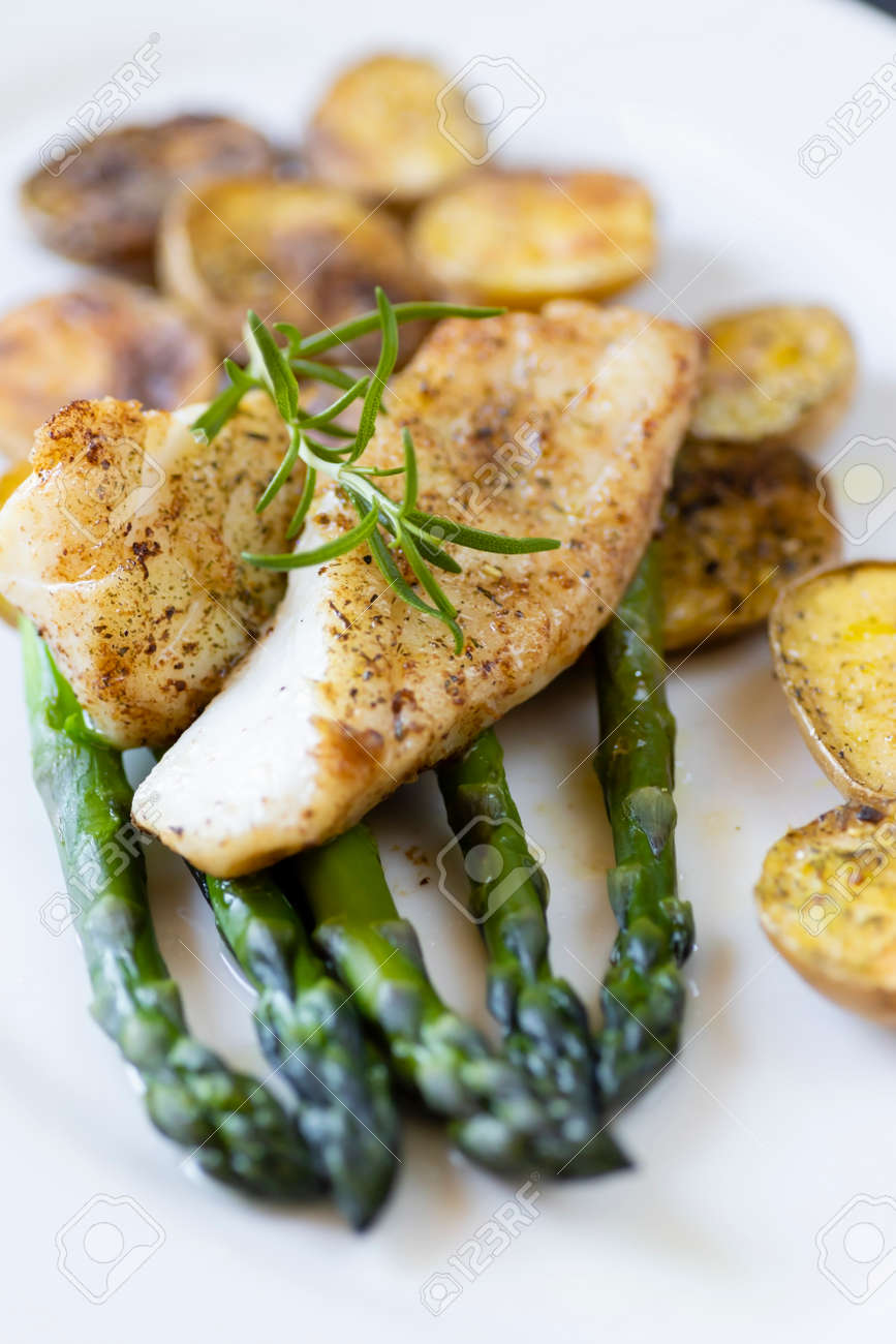 cod with green aparagus and roasted potatoes - 169975936