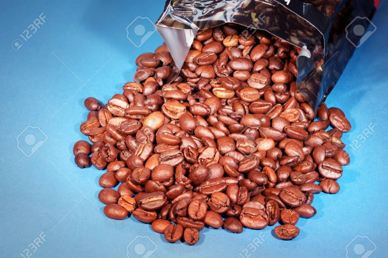 Close-up of coffee beans spilling out of packet Stock Photo - 8401076