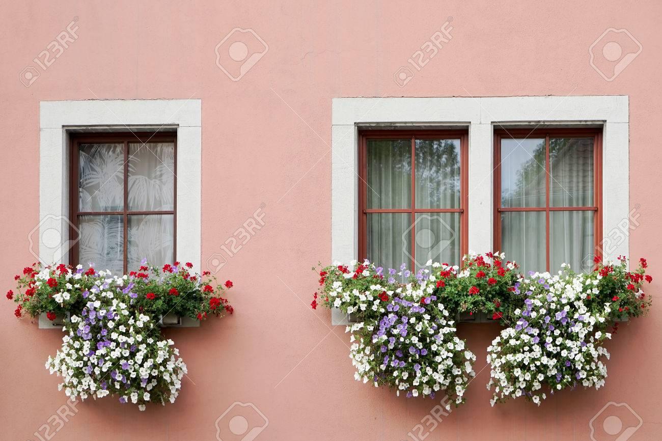 Beautiful Flower Baskets Beneath Windows In Rothenburg Stock Photo