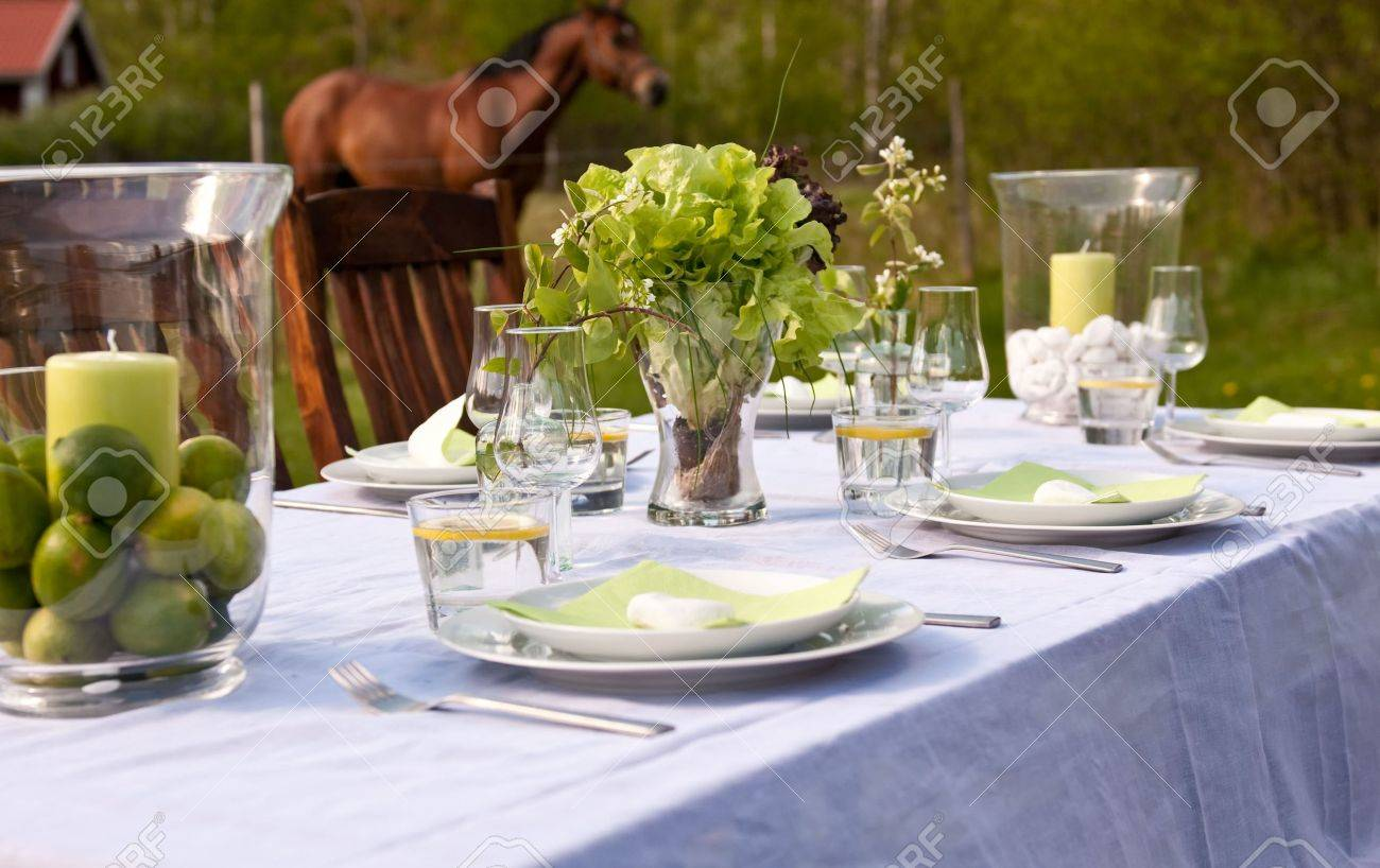Table Setting Background table setting outdoors with horses in the background stock photo