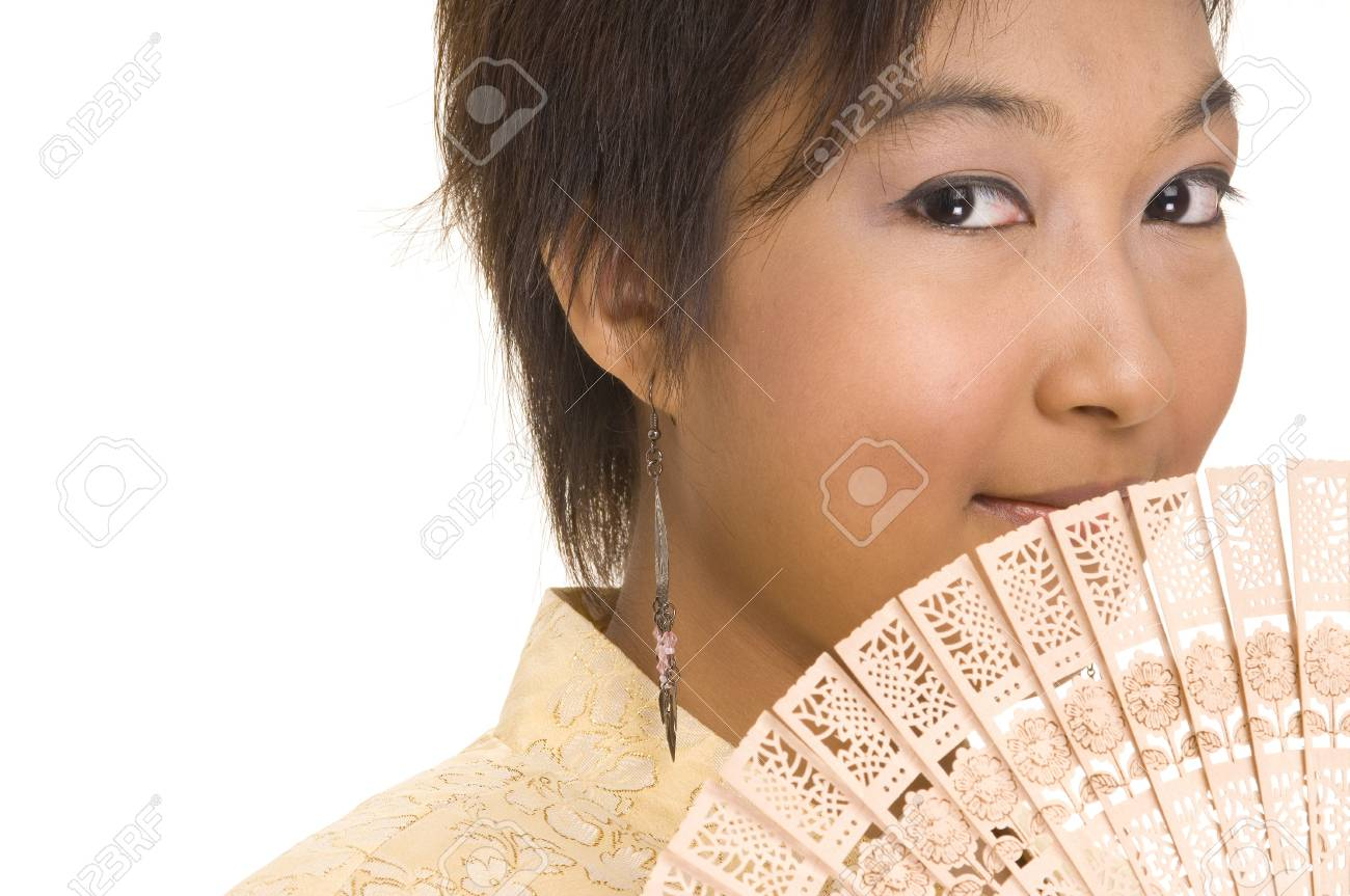 A young asian woman holds a fan to her face Stock Photo - 221059