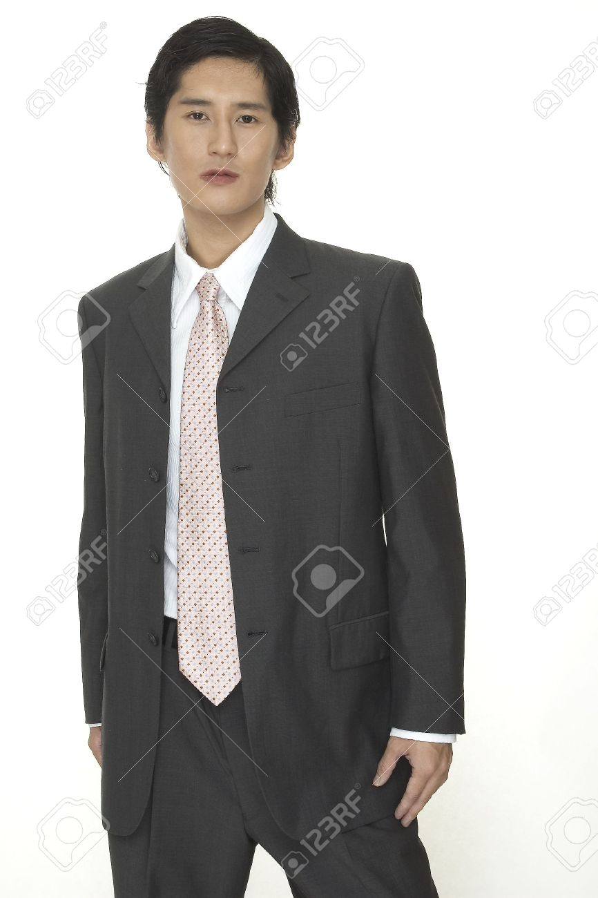 An Asian Businessman In A Smart Grey Suit With Pink Tie Stock ...