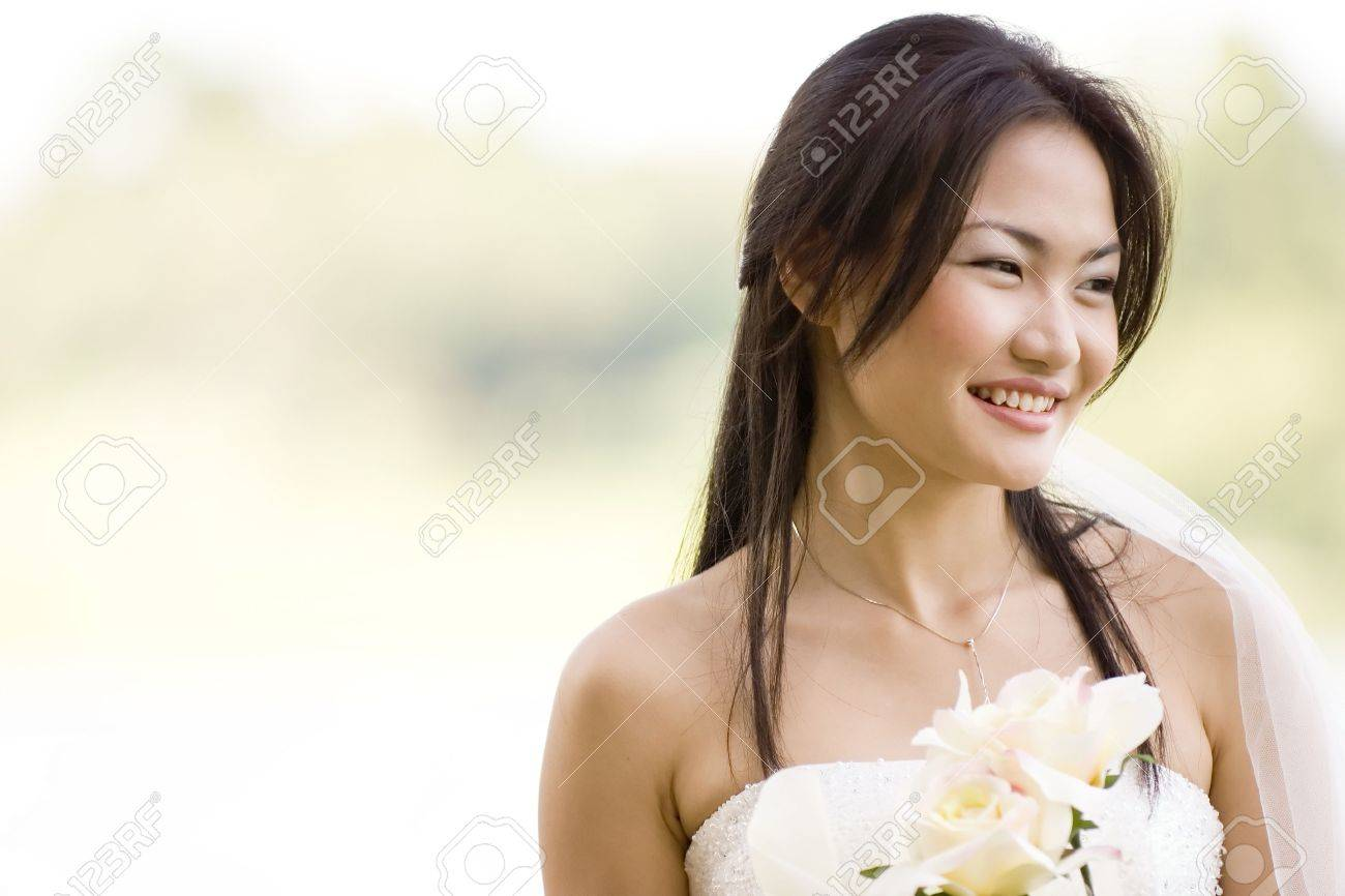 A beautiful asian bride poses outside Stock Photo - 235381