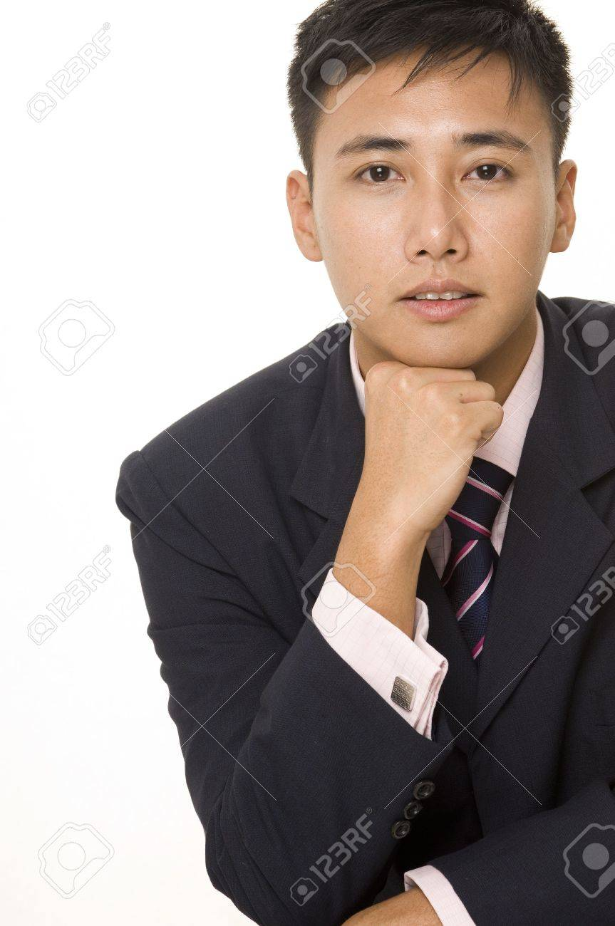 A Young Asian Businessman In Smart Dress Rests His Chin On His