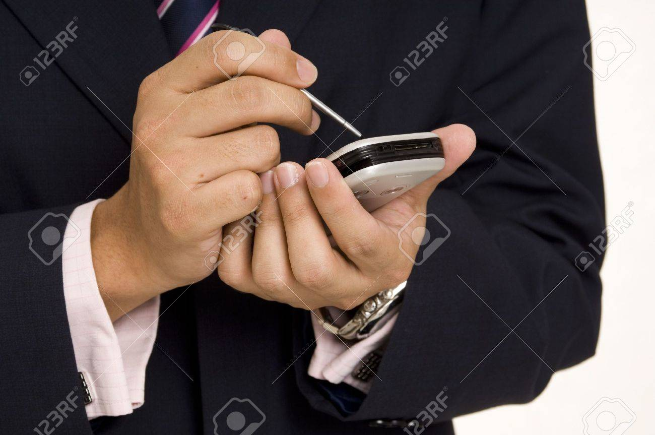 A businessman in a navy suit and pink shirt uses a handheld computer Stock Photo - 235364