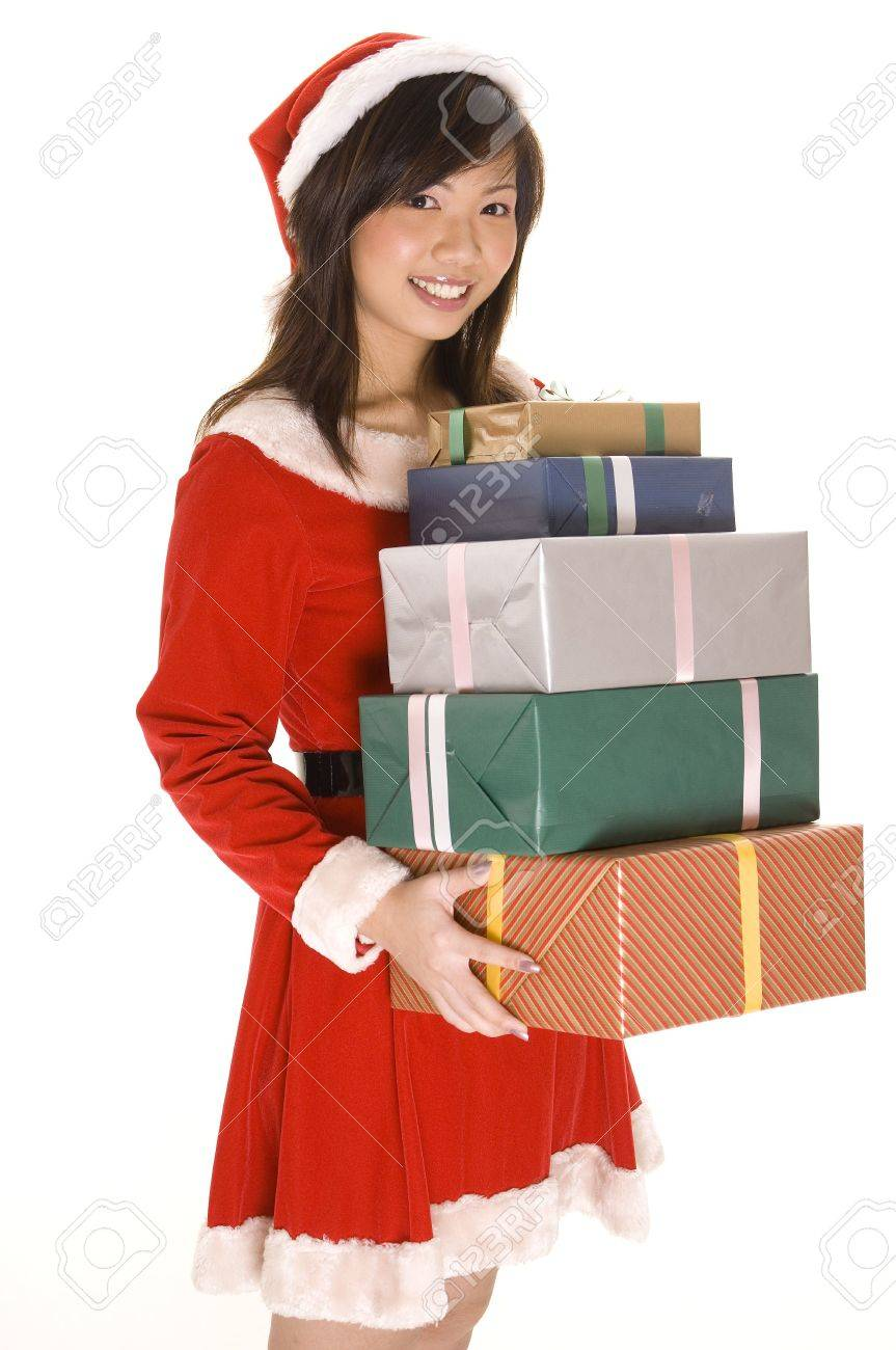 A cute asian Miss Santa with lots of different colored presents Stock Photo - 242714