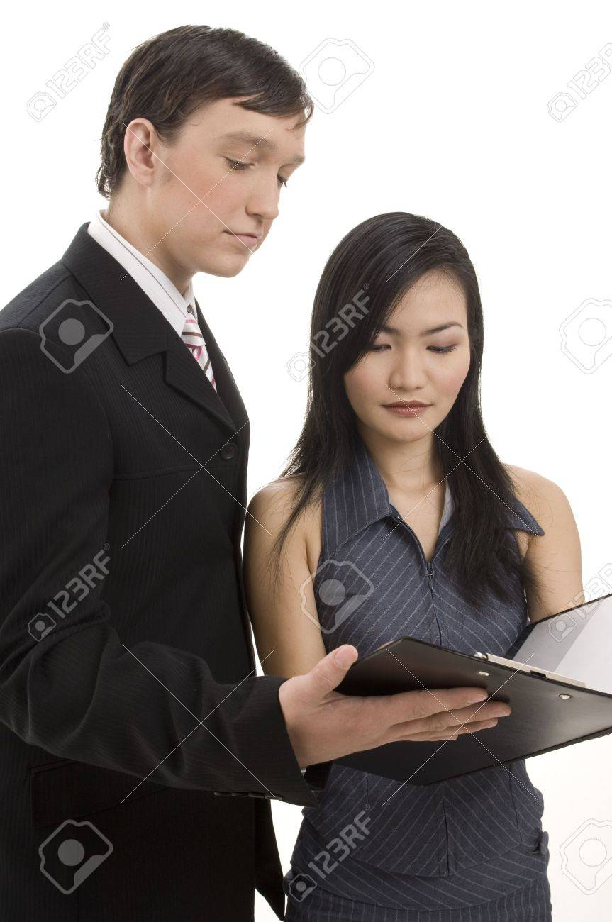 A business man and woman look over a contract in a clipboard. Isolated on white background Stock Photo - 243497