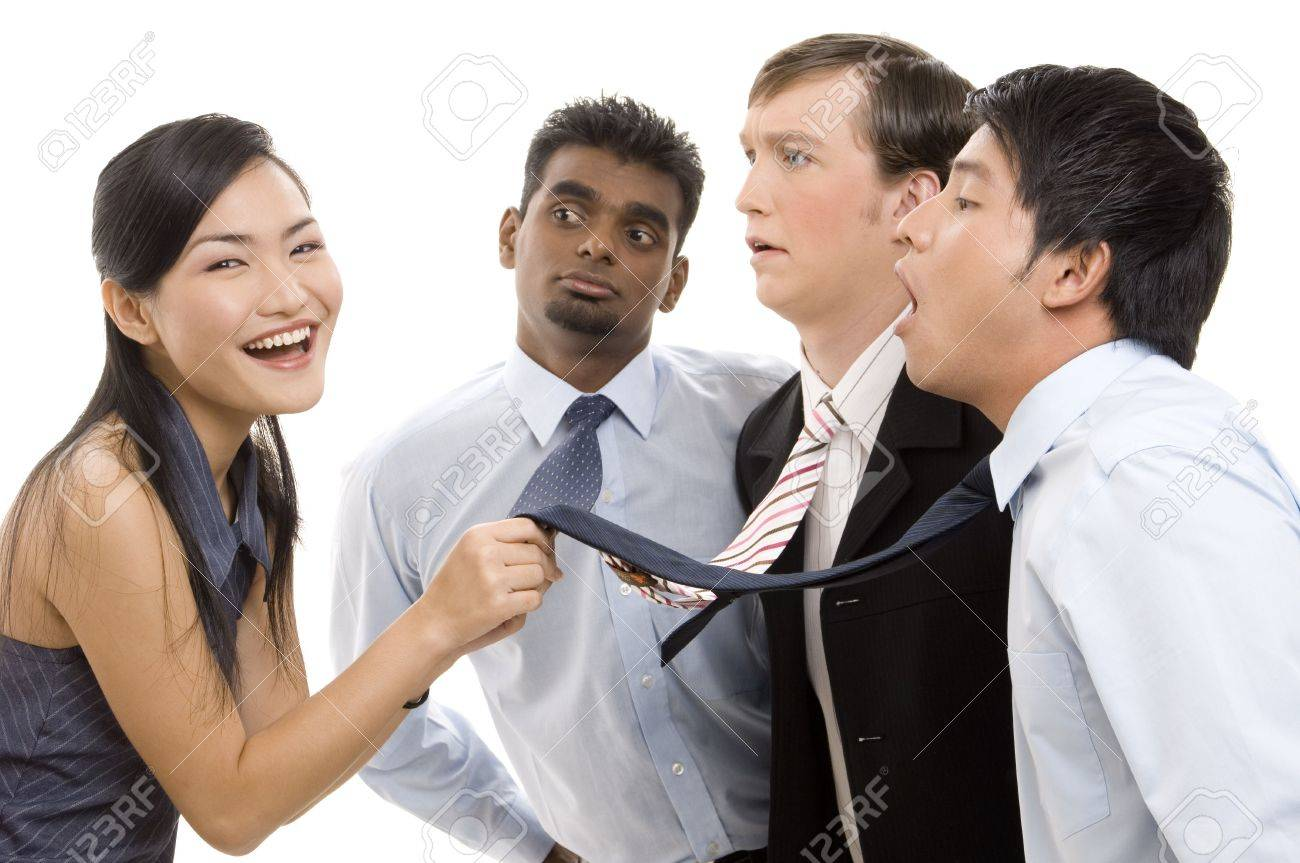 A laughing chinese businesswoman has three of her colleagues exactly where she wants them Stock Photo - 247098
