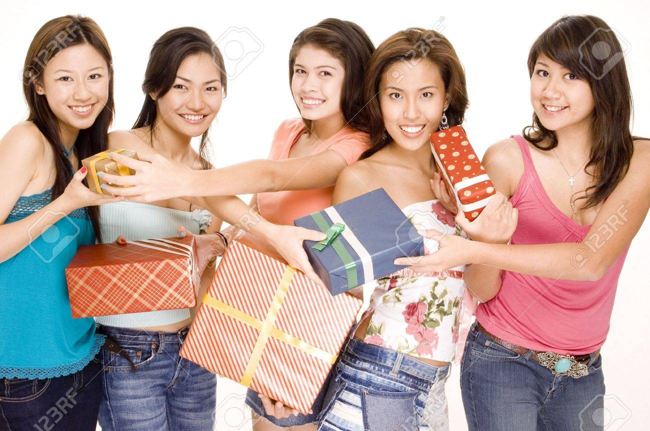 Five pretty asian women swap gifts and presents Stock Photo - 299589
